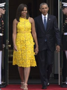 First Lady Michelle Obama wore a lacy, sleeveless yellow floral dress by Naeem Khan, the Indian-American designer who is one of her favorites, to tour the National Gallery of Art with Ho Ching.     Save Save Save Related PostsFirst Lady Michelle Obama Wears a Naeem Khan At The Cuba State DinnerFirst Lady…