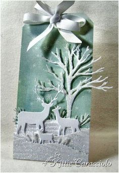 Winter tag ... on for the TwelveTags of Christmas ... luv the aqua colors and glittery highlights on the snow banks ... white Memory Box die cuts of tree and deer family ... gorgeous!!