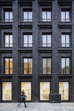 Gridded brick facade. This looks so good! Painting brick buildings black is such a good idea!