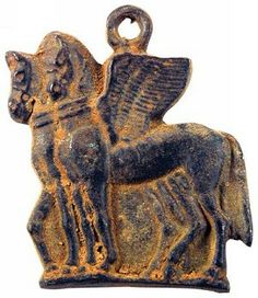 Bronze pendant of a pair of bridled winged horses, believed to have carried the sun across the sky, Roman, ca 100-300 A.D.