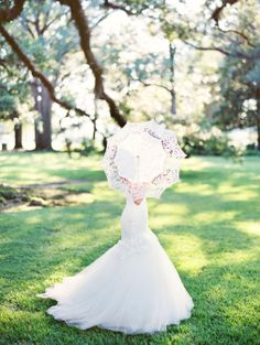 Gorgeous bride with lace umbrella www.marissalambertphotography.com