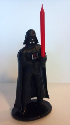 Darth Vader cake topper candle holder w/ lightsaber, for your Star Wars boy birthday space themed party or wedding by AisforApronStrings on Etsy https://www.etsy.com/listing/106332861/darth-vader-cake-topper-candle-holder-w