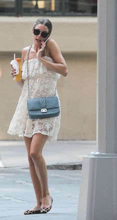 The Olivia Palermo Lookbook : Olivia Palermo grabs a Orange juice drink in New York City.