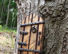 I make these doors from used horse shoes, hand forged hardware, and repurposed items. 5 inches tall and 4 inches wide. All your wee folk will Fairy Tree Houses, Fairy Garden Houses, Fairy Garden Doors, Fairy Doors, Used Horse Shoes, Fairy Tea Parties, Gnome House, Ceramic Houses, Repurposed Items