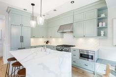 Kitchen renovation by Madeleine Design Group in the West End of Vancouver, BC. *Re-pin to your own inspiration board*