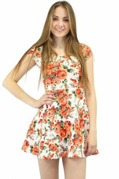 Uptown girl dress. A white skater dress featuring an all over floral pattern.