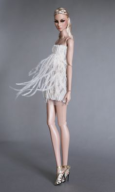 Giselle spun around in a swirl of feather dress.