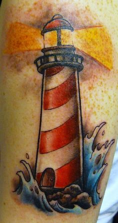 Lighthouse tattoo. Maybe get this one but the water wouldn't be blue, I would just shade that.