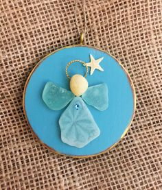 A personal favorite from my Etsy shop https://www.etsy.com/listing/506338392/beachcomber-angel-ornament