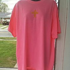"Cross-stitched Cross T-Shirt I've cross-stitched a gold cross on this hot pink t-shirt.  The cross sends a simple yet powerful message. No words are needed! Measures 32"" long & 22"" from side to side. Made of 50% cotton & 50% polyester. This is machine washable & dryer safe.   #0315  5/5 Gildan Tops Tees - Short Sleeve"