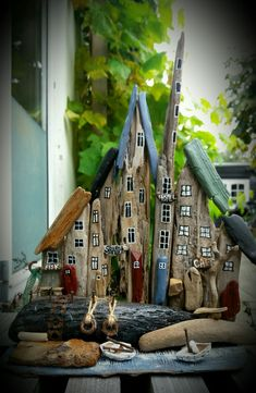 Little driftwood town/houses, boats, harbour. Made by EVAS.
