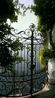 Beautiful gate looking over Lake Varenna, Province of Lecco, Lombardy, Italy Door Gate, Fence Gate, Garden Gates And Fencing, Comer See, The Secret Garden, Grades, Wrought Iron Gates, Iron Work, Entrance Gates