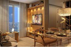 Sala de estar com iluminação aconchegante de apartamento de 47m² em Campinas.