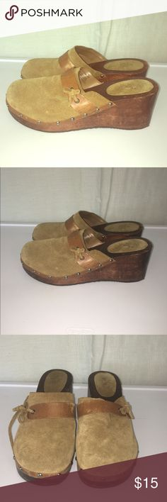 American Eagle Leather Clogs-9 A pair of leather and wooden clogs from American Eagle Outfitters. The worn leather makes it a perfect look for casual but fashionable looks and can be worn in any season. Some of the tie material has been worn but can easily be replaced with leather ties. American Eagle Outfitters Shoes Mules & Clogs