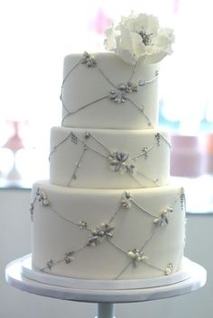 Silver Jeweled Cord Cake with Sugar Flower by Sweet and Saucy Shop. www.sweetandsaucyshop.com