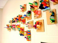 These paper sculptures were made by kindergarteners and first-graders learning…