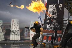 A protester throws a petrol bomb towards riot policemen in Taksim Square, on June 11, 2013