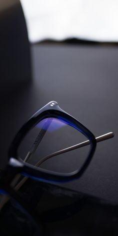 56199b4f74b An androgynous pair of square blue glasses frames for men and women. Each  pair has