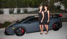 """Models pose with a Lamborghini Gallardo during an eventful evening in a newly built Hollywood Hills home, organized with the luxury real estate agency """"The Agency."""""""