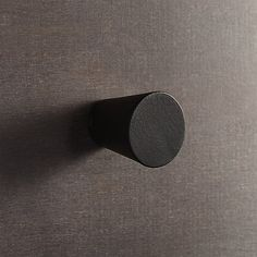 Shop aluminum black knob.  Elegant tapered cylinder gives a modern finishing touch to doors and drawers, even antiques.