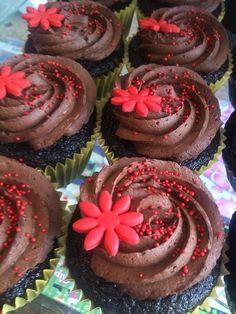 Yummy chocolate cupcakes with chocolate icing