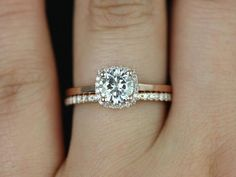 love the simple band on the engagement ring and the studded wedding band