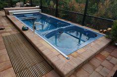 19' Dual Temp Swim Spa with underwater treadmill. Quite beautiful!