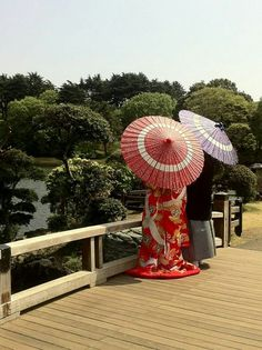 A couple with traditional costumes and umbrellas...