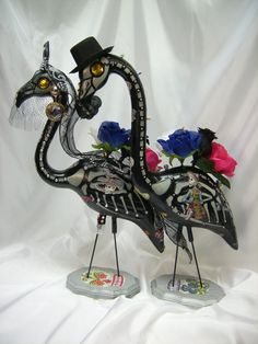 Day of the dead skeleton flamingos.