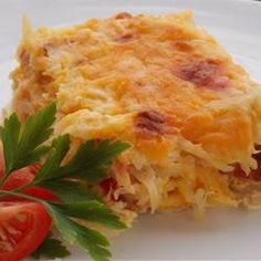 Sunday Brunch Casserole | Bacon, eggs, cheese & potatoes baked into a hearty brunch worthy casserole.