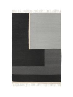 Kelim rug in 80% wool and 20% cotton with a significant graphic touch. The cool and neutral grey scale makes it easy to incorporate into your own personal home styling. Our Kelim Rugs are all hand mad