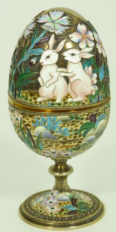 Russian silver enameled hinged egg box depicting rabbits with flowers. Gold wash throughout. Holds double headed eagle, Cyrillic Pavel Akimov Ovchinnikov workmaster