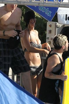 "Katy Perry reveals her sexy curves in a bikini during a trip to ""Raging Waters"" waterpark."