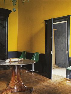 "Green Eames shell chairs + Farrow & Ball yellow ""Chinese Emperor"" wallpaper 
