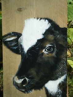 Zwart bont kalfje geschilderd met acryl op steigerhout door Ineke Nolles.