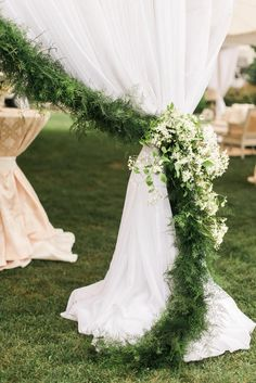 line the edges of your tent with greenery and finish with a bunch of fragrant blooms for a luxe touch at your wedding