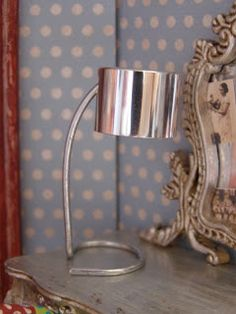 Modern table lamp made with perfume/lotion cap and wire