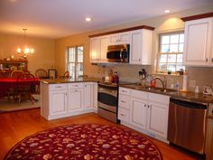 kitchen remodel, painted cabinets, stained crown molding, stainless steel appliances, wood floors