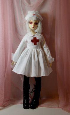 Red Cross Nurse in White