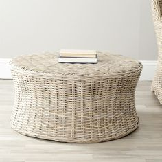 This ottoman brings an island resort feeling to the room with beautifully woven, washed-out natural wicker and a sturdy wood frame.