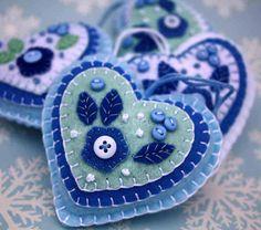 Felt Christmas ornament. Blue and white heart decoration, holiday decor