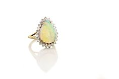 This Opal and Diamond ring is yet another cool piece from our Estate Jewelry Collection