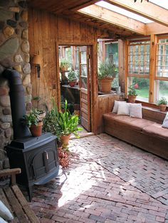 R-r-rustic. Couldn't do bricks on floor; perhaps chimney instead; don't like the rocks anyway. Like all the natural light, and natural wood, and plants, and black little stove.