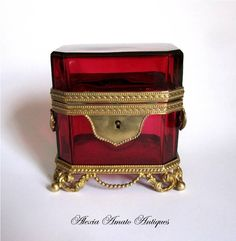 A French 19th Century Ruby Red Glass Casket with Stunning Dore Bronze Mounts.    Rectangular Casket with Four Scrolling Feet and Stylish Handles on Either Side. Super Quality Dore Bronze Mounts.