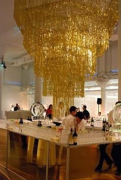 Giant tinsel chandeliers...have to be cheap to do.
