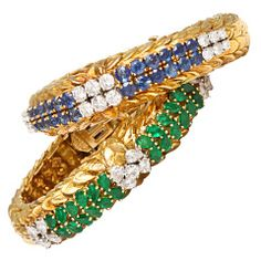 DAVID WEBB BANGELES AND BRACELETS | David Webb pair of sapphire, emerald and diamond bracelets