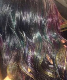 Oil slick hair offers a less-aggressive alternative to the pastel hair trend but makes just as big of a statement.
