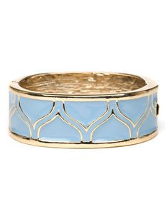 Dazzle plenty in this stylish cuff, which comes cast in sparkling gold and boldly accented with powder blue enamel. The graphic petal pattern, meanwhile, adds a lovely textural intrigue.