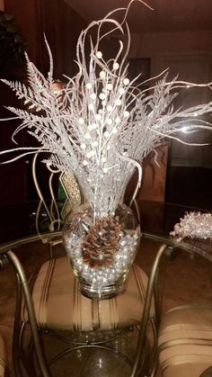 silver christmas 100 DIY Christmas Centerpieces You'll Love To Decorate Your Home With For The Christmas Season - Hike n Dip Christmas Vases, Christmas Table Centerpieces, Christmas Candle Holders, Christmas Arrangements, Diy Centerpieces, Silver Christmas, Xmas Decorations, Rustic Christmas, Christmas Holidays