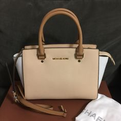 """Michael Kors Tricolor Medium Selma Brand New Michael Kors Tricolor Selma in Nude/White/Peanut, Saffiano Leather, double handles, adjustable shoulder strap, top zip closure, 2 interior slip pockets, 1 zip pocket, 13"""" L x 4"""" W x 8"""" H, 6"""" handle drop, 17.5"""" to 19.5"""" strap drop. This bag comes with a dust bag. It has a pen mark and please see the last pic regarding this Michael Kors Bags Crossbody Bags"""